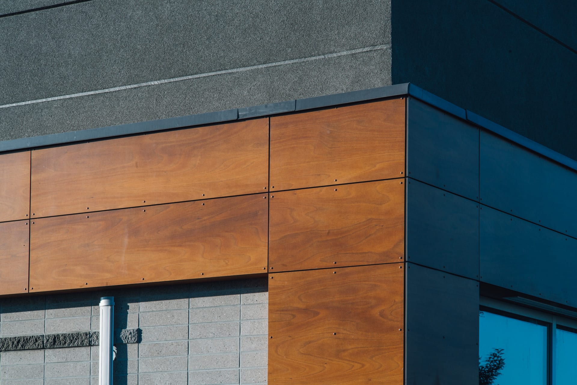 Wood composite panels / Phenolic Resin Panels, on the corner of a building.