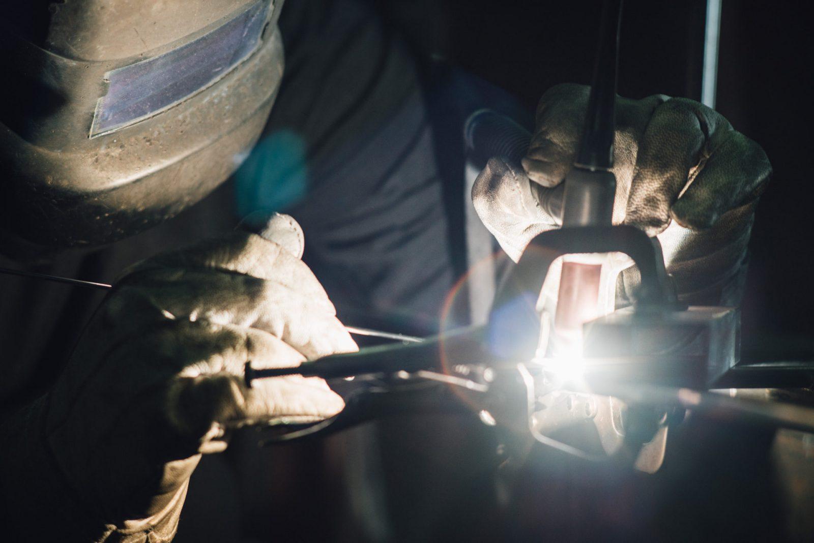 IMARK employee doing custom welding
