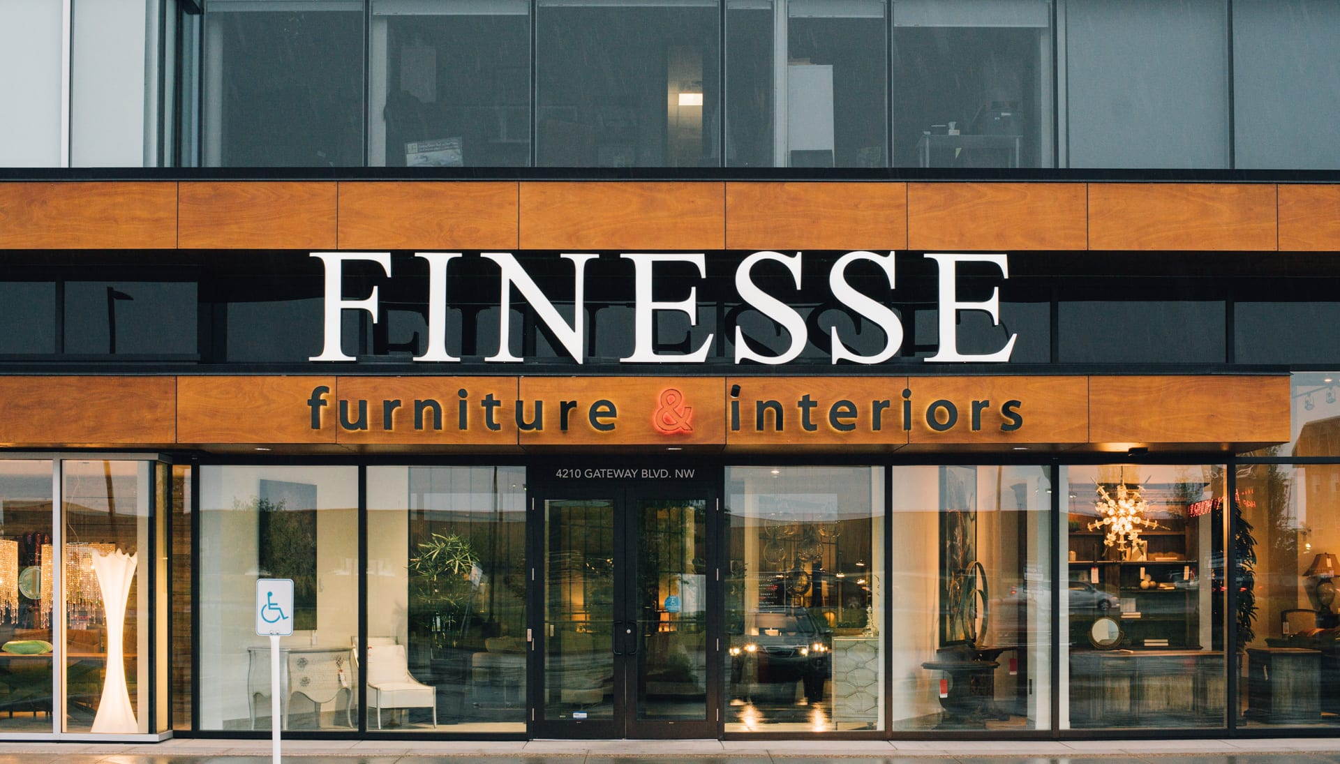 Wood paneling on the front of Finesse Furniture & interiors.